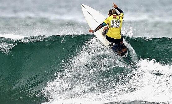 Makayla surfing in a USA jersey